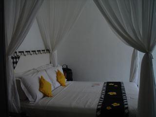 チャンディビーチコテージ デラックスコテージのベッド